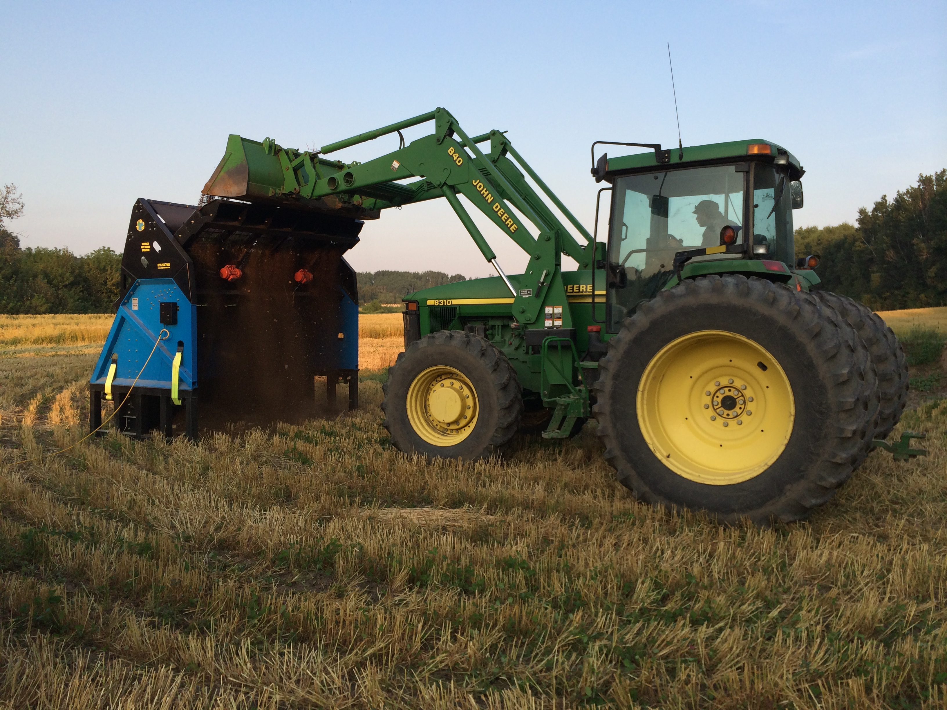 Saskatchewan Local farmer with a topsoil screener SLG-108VFRB