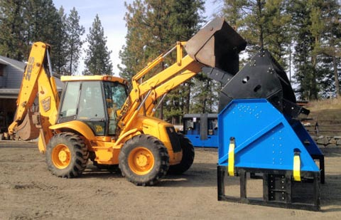 Topsoil Screener can be fed with skid steers and backhoes.